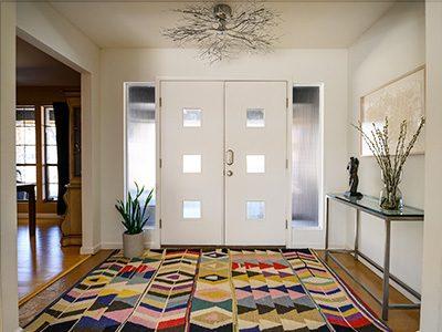 front door geometric carpet twig chandelier